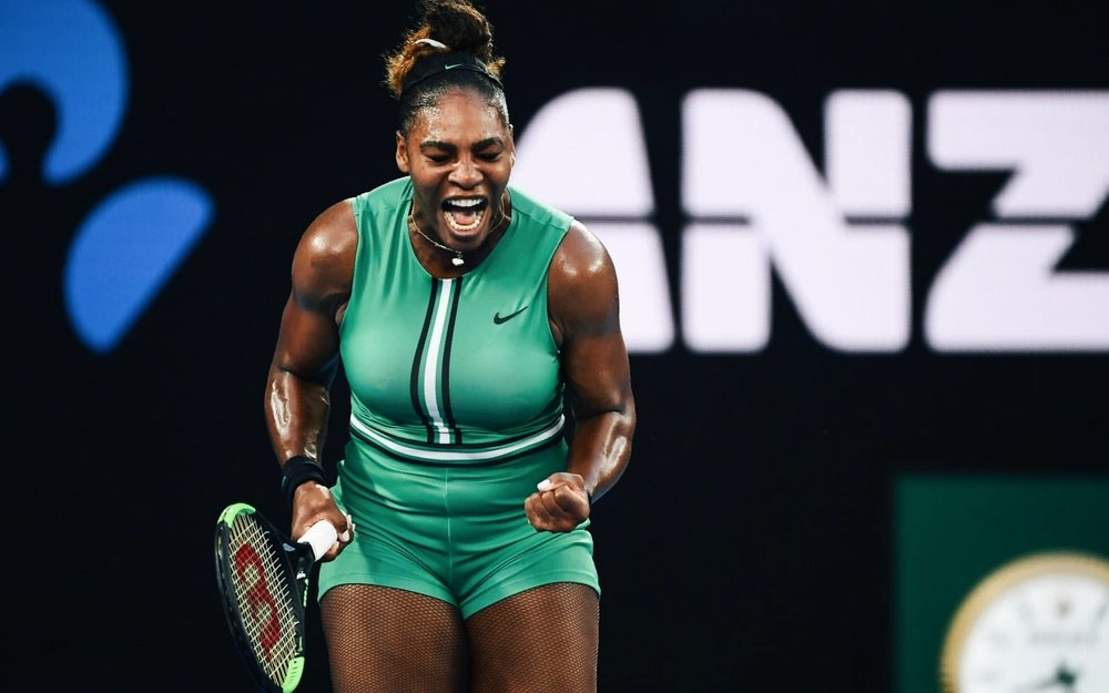 Serena Williams celebrates a point against Simona Halep