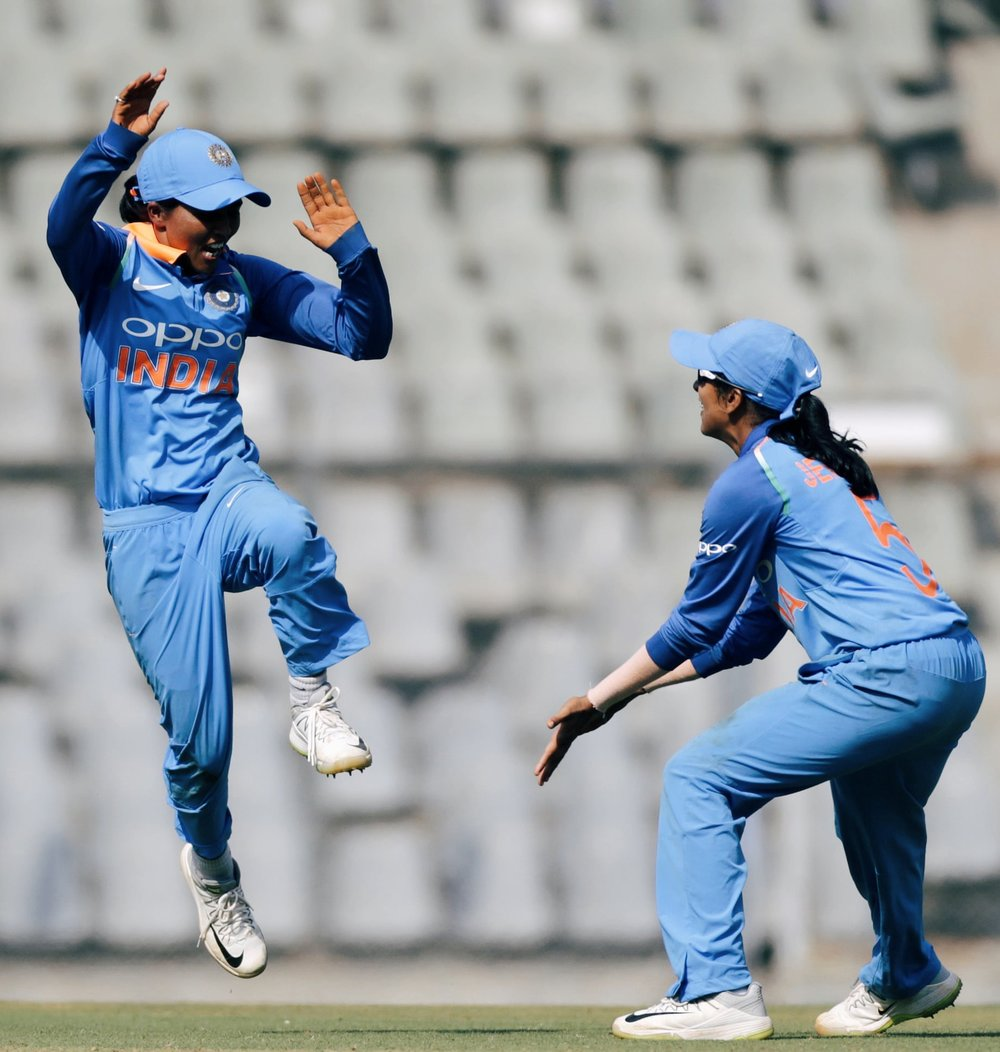 Ekta Bisht (left) celebrates with Jemimah Rodrigues after her figures of 4-25 helped India to victory. Img: Rajanish Kakade/AP