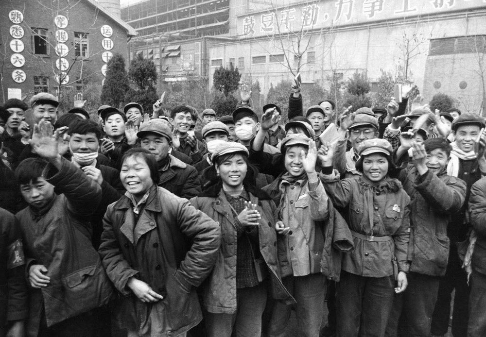 Chinese factory workers waving copies of Chairman Mao's  Little Red Book , nine months after the start of the Cultural Revolution. Photo: Star Tribune
