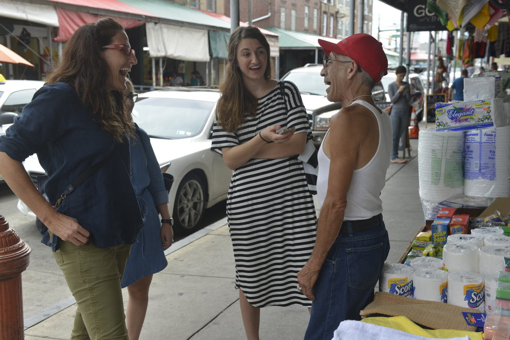 Carolyn Cannuscio, Roxanne Dupuis, and Amy Graves in the Italian Market, conducting a street intercept interview for the Community Health and Literacy Center needs assessment.