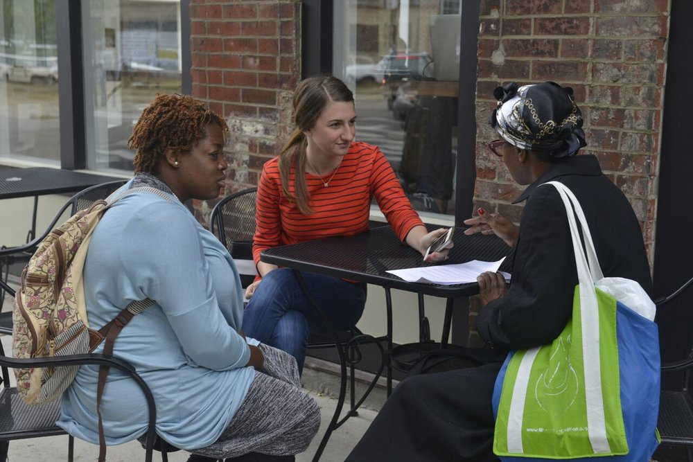 Kiahana Brooks and Amy Graves conducting an interview with a local South Philadelphia resident during the needs assessment for the Community Health and Literacy Center.