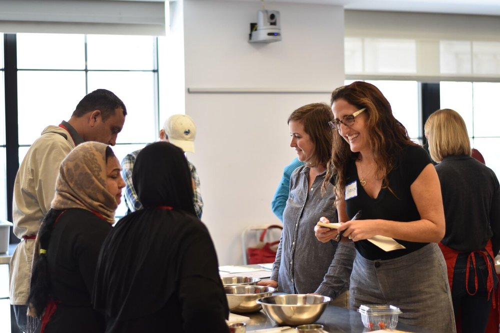 Carolyn Cannuscio works with students in the Edible Alphabet program, an ESL and cooking class for refugees. The class is run through the Free Library of Philadelphia's Culinary Literacy Center.
