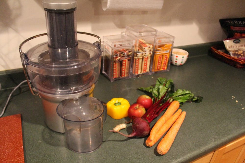 Breville juicer with sweet pepper, apple, ginger, beet, and carrots