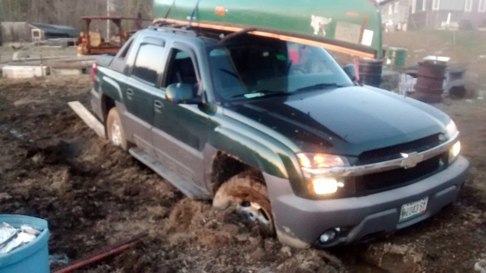 Truck stuck in mud and manure