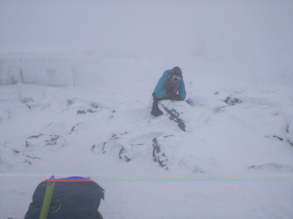 Dale is taking a picture of me taking a picture on the summit. The camera batteries were nearly dead because of the cold.
