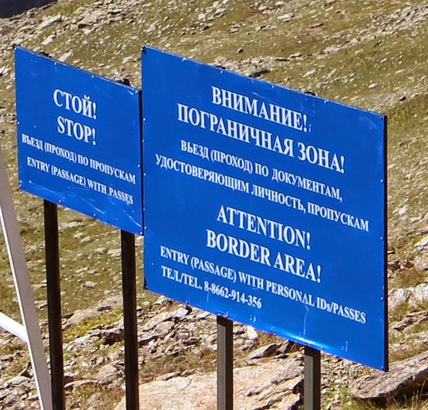 Sign on the border of Georgia and Russia on Mount Cheget.