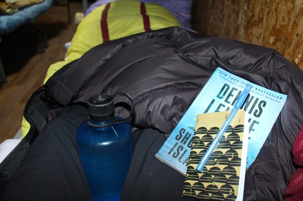 At night in the barrel huts, I used a hot water bottle in my down sleeping bag to keep me warm. I wrote in my journal every day and also had my book to read. This kept me busy during our down time on the mountain.