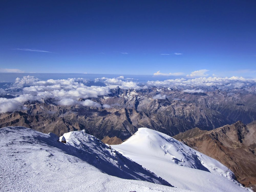 Beautiful view above the clouds from the summit of Mount Elbrus in Russia