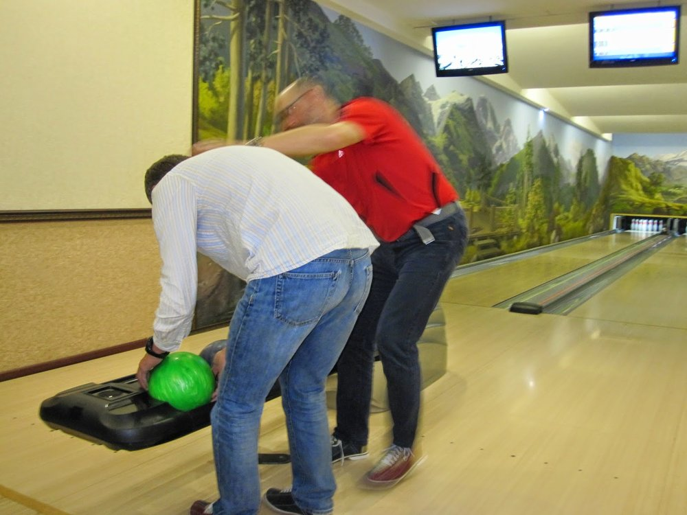 Making sure Roman doesn't kill someone accidentally with his bowling ball