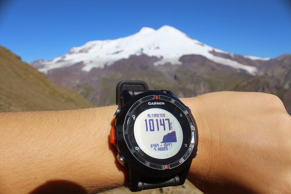 Checking the altitude on my Garmin Fenix on Mount Cheget.