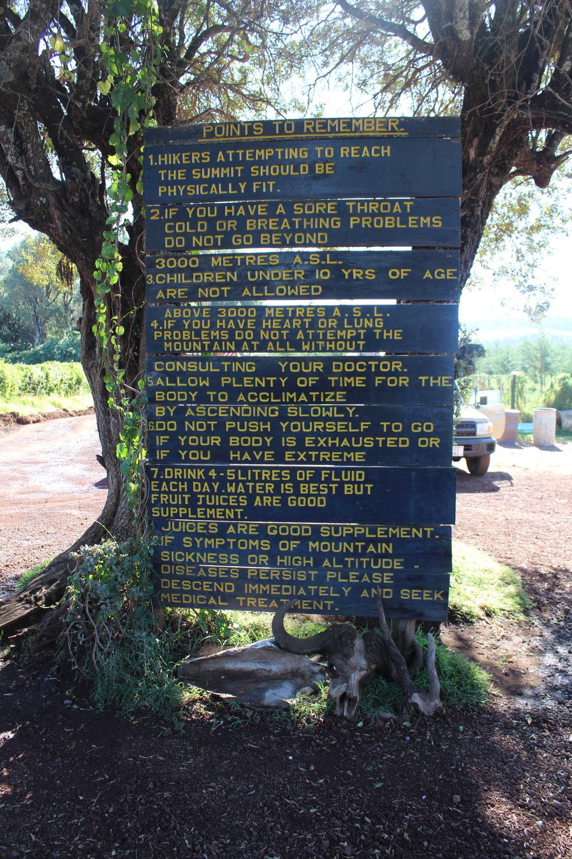 Sign at the Lonsorossi Gate showing warnings of Mount Kilimanjaro.