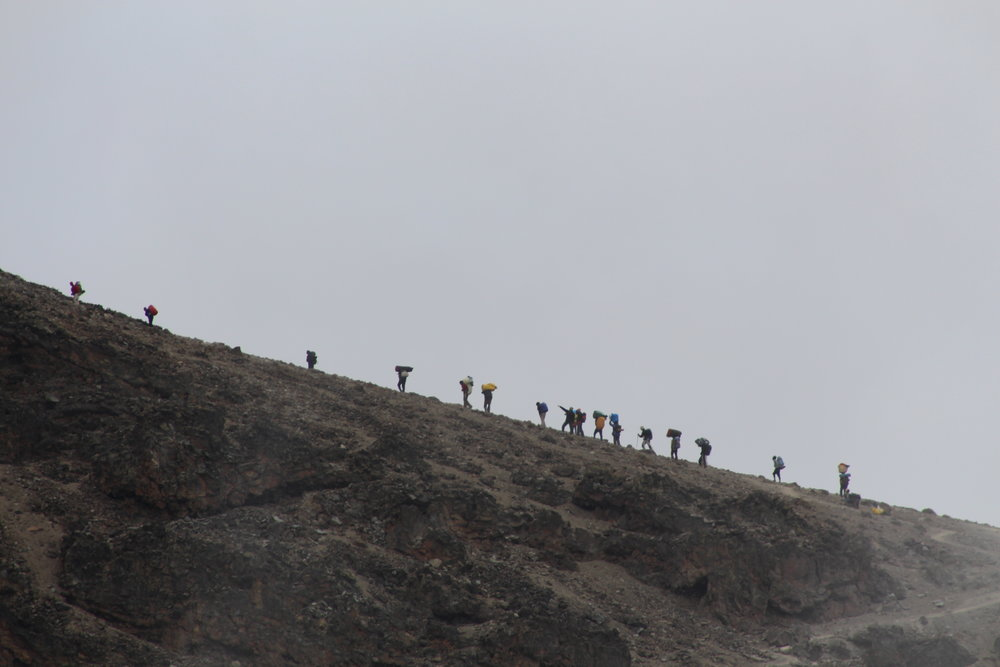 Silhouette of porters on the ridge to Barafu Camp