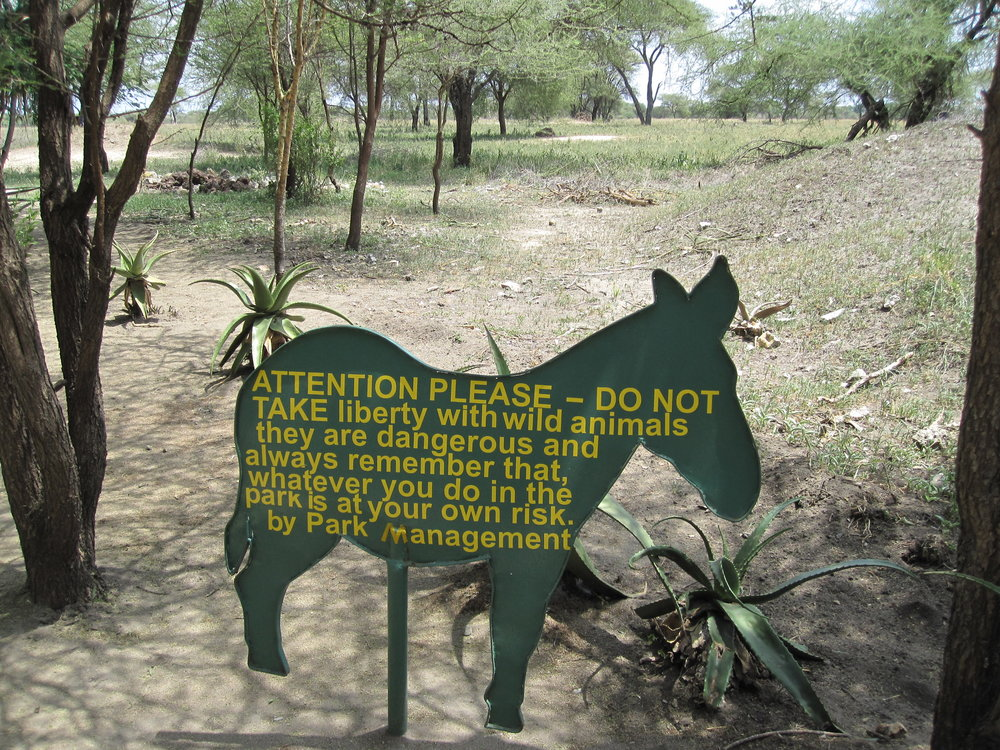 Warning wild animals sign at Tarangire on our safari.