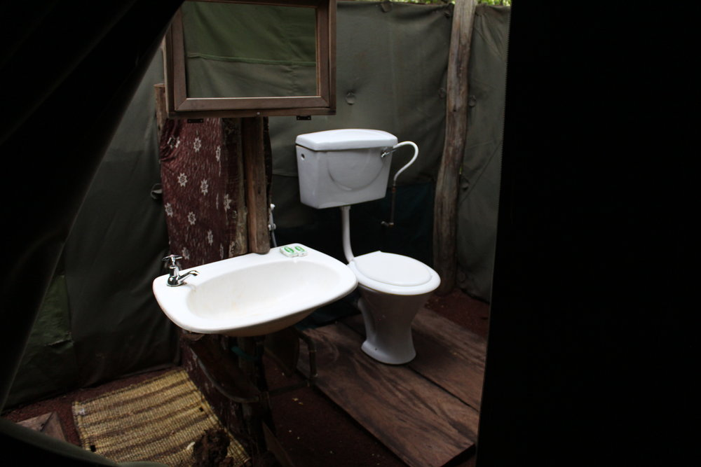 Outdoor private toilet in the jungle on our camping safari