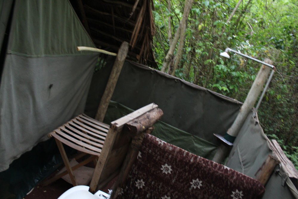 Outdoor shower in the jungle on our camping safari!