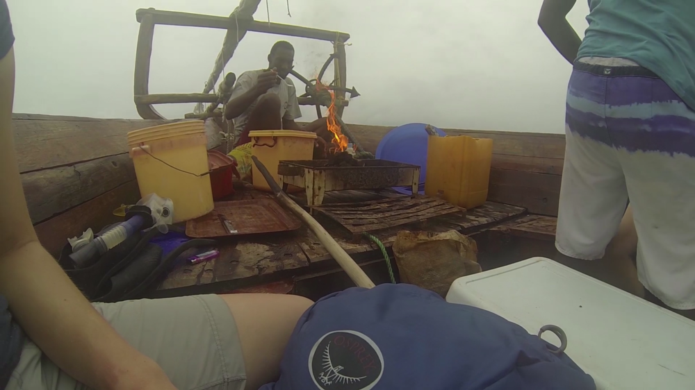 Cooking with open flames on a wooden boat in Zanzibar