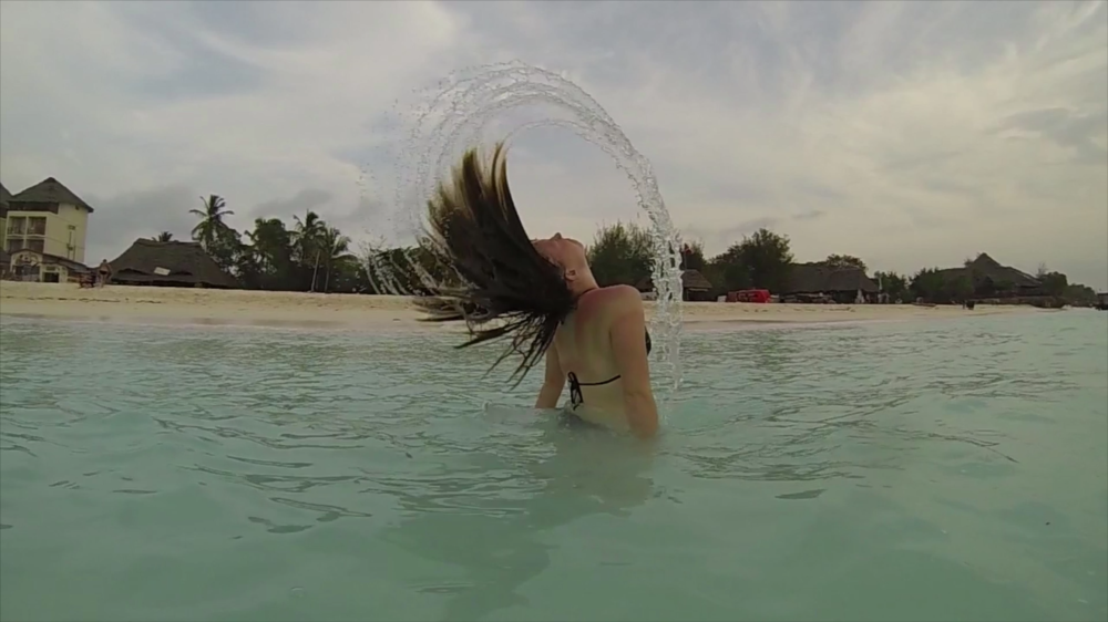 Flicking water from my hair in the water