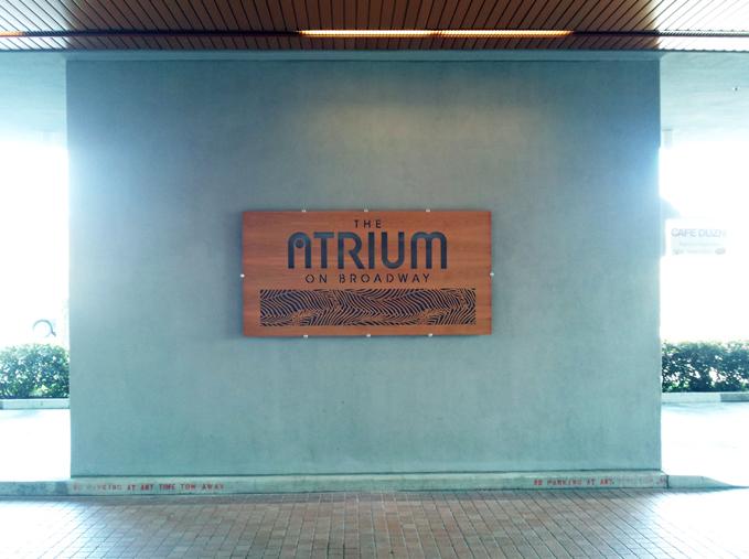 Laser cut outdoor wood custom sign Atrium