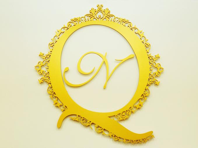 Laser cut signage logo gold painted nail salon
