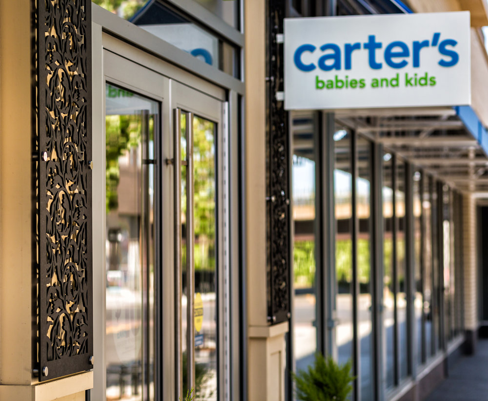 Carters, Commonwealth Building, Assembly Row Storefronts, Quincy, MA    Crocus Spirals, Laser cut phenolic outdoor decorative panels
