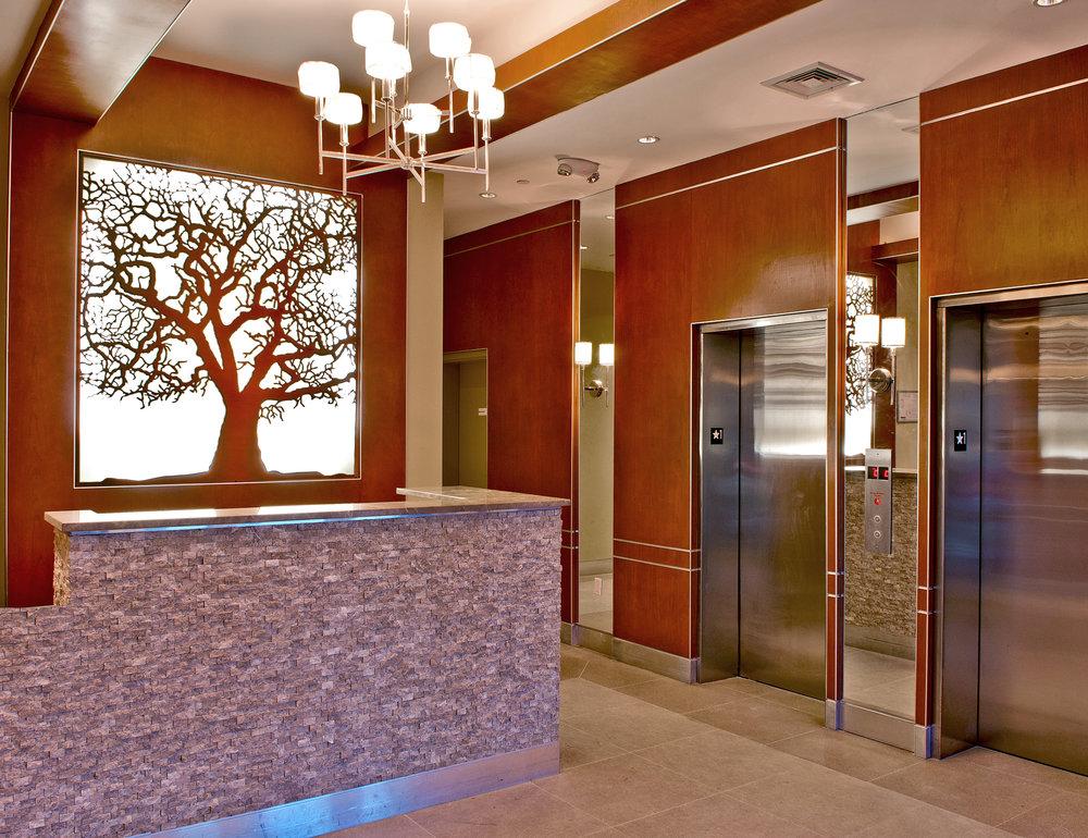 Sycamore Lobby Apartments, NY - Clearview Development  Custom Tree, back lit panel