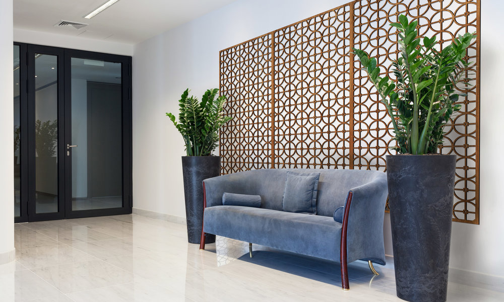 Installation Rendering A   Circles Grille decorative office wall panel - shown in Cherry