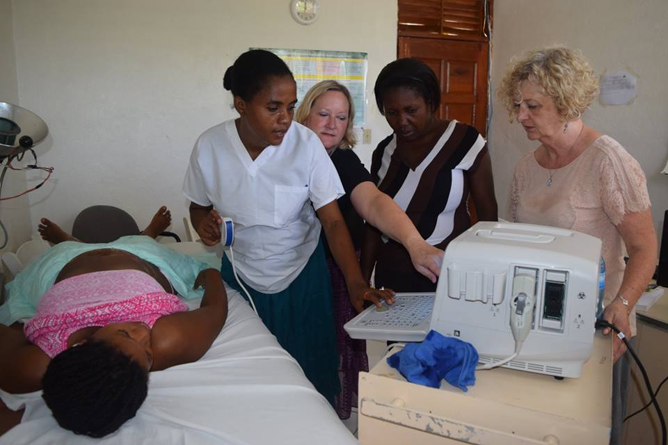 Dr. Betsy Wickstrom conducts an ultrasound on a patient at Maison de Naissance.