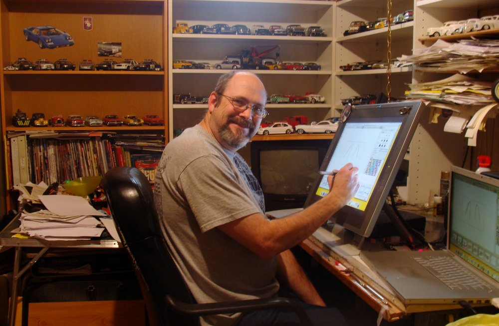 Mark Ervin hard at work in his home office.