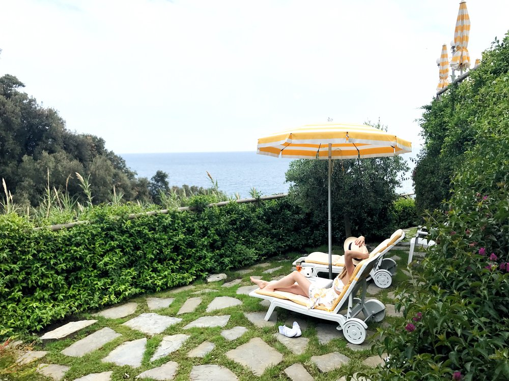 Lounging cliffside at Porto Roca hotel in Monterosso al Mare, a village in Cinque Terre.