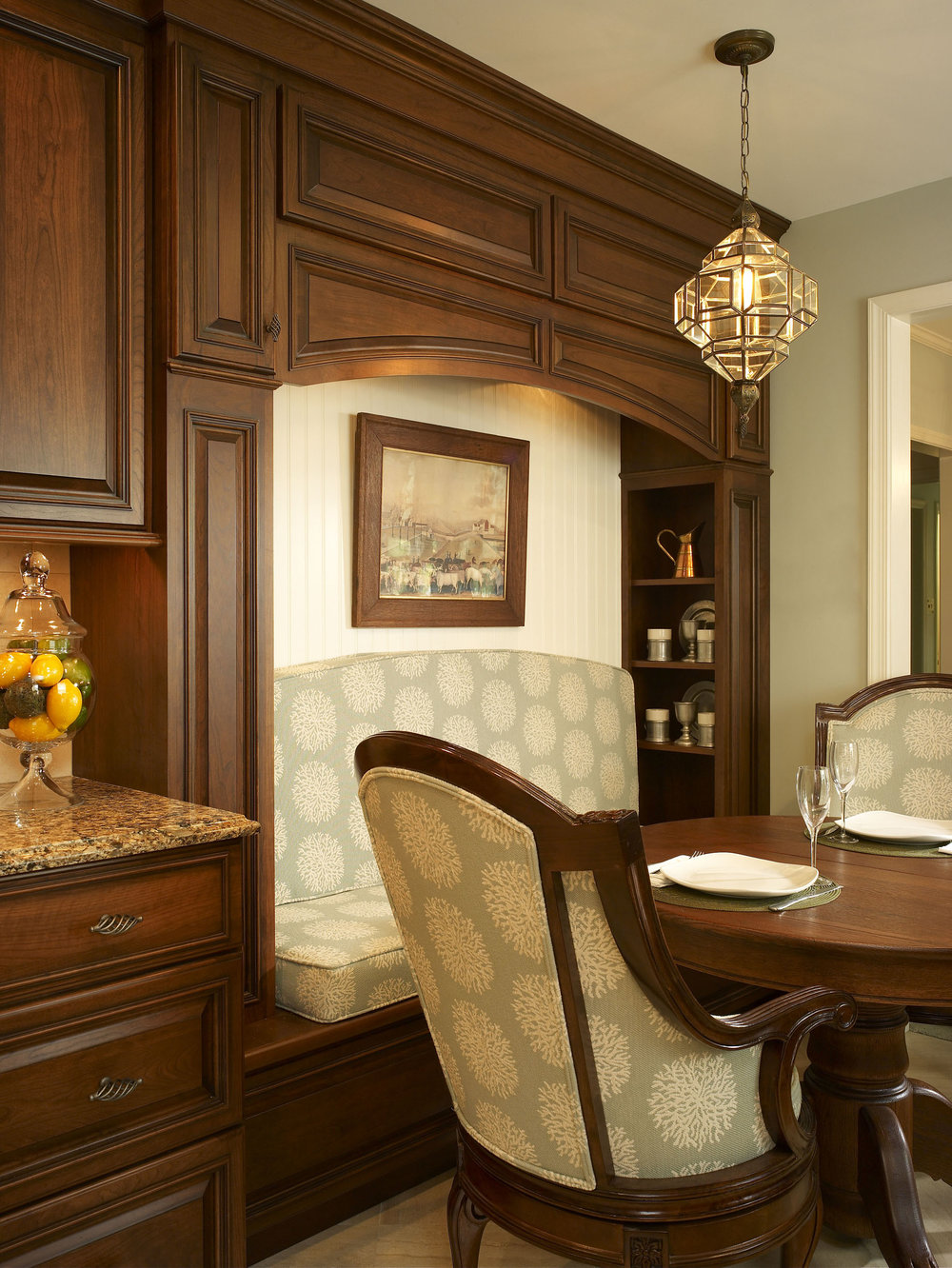 Custom designed eat-in nook with hidden storage in cabinet panels.