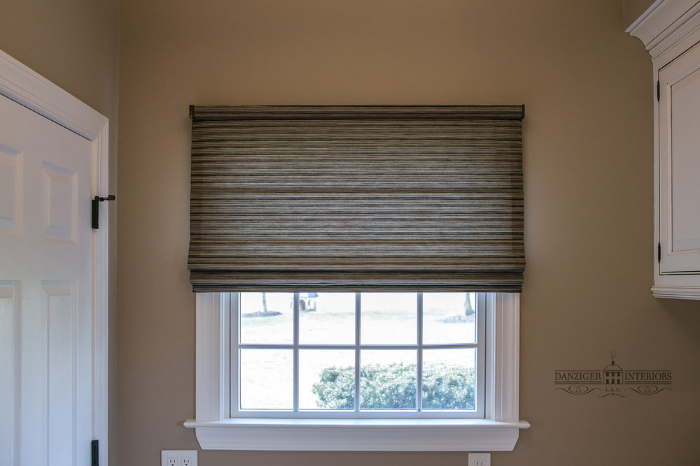 Hunter Douglas Roman Shades.