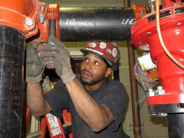 electrician with pumps.jpg