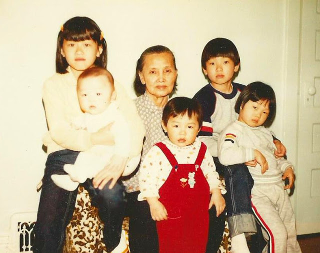 In the early 1980s with my grandma, brother and sister to the far right and our cousins.