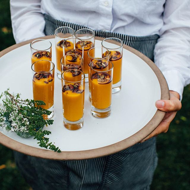 Golden butternut squash soup shooters with pomegranate gastrique and spiced pepitas! Perfect little dose of fall comfort food. 🍁