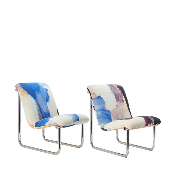 pair of upholstered vintage chrome chairs