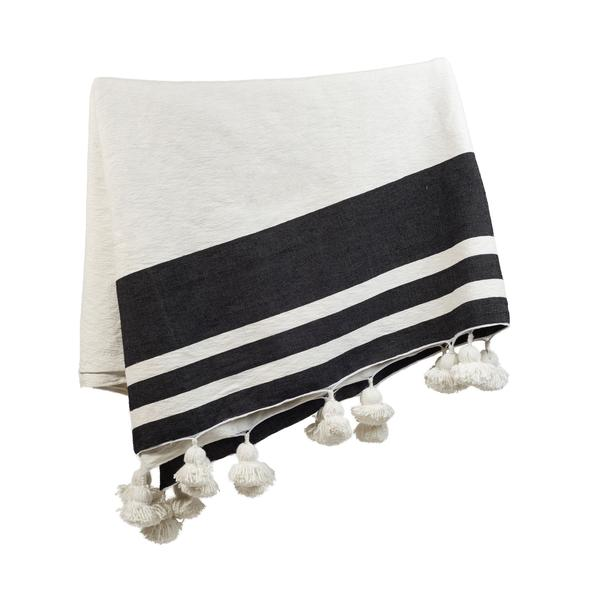 white + black pom throw