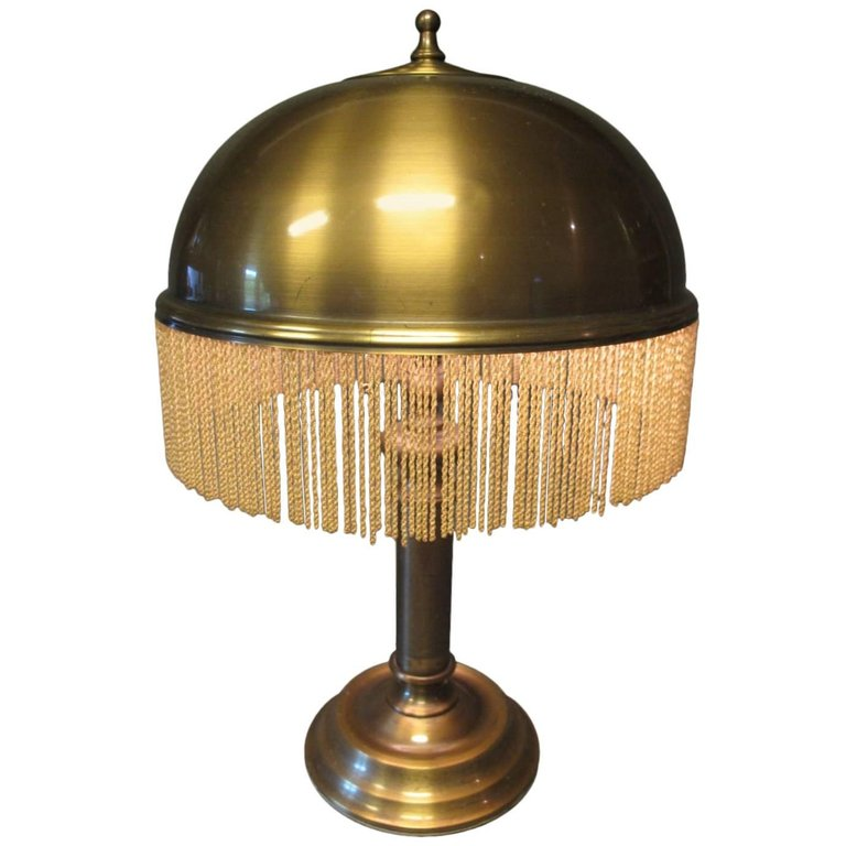 brass + fringe table lamp