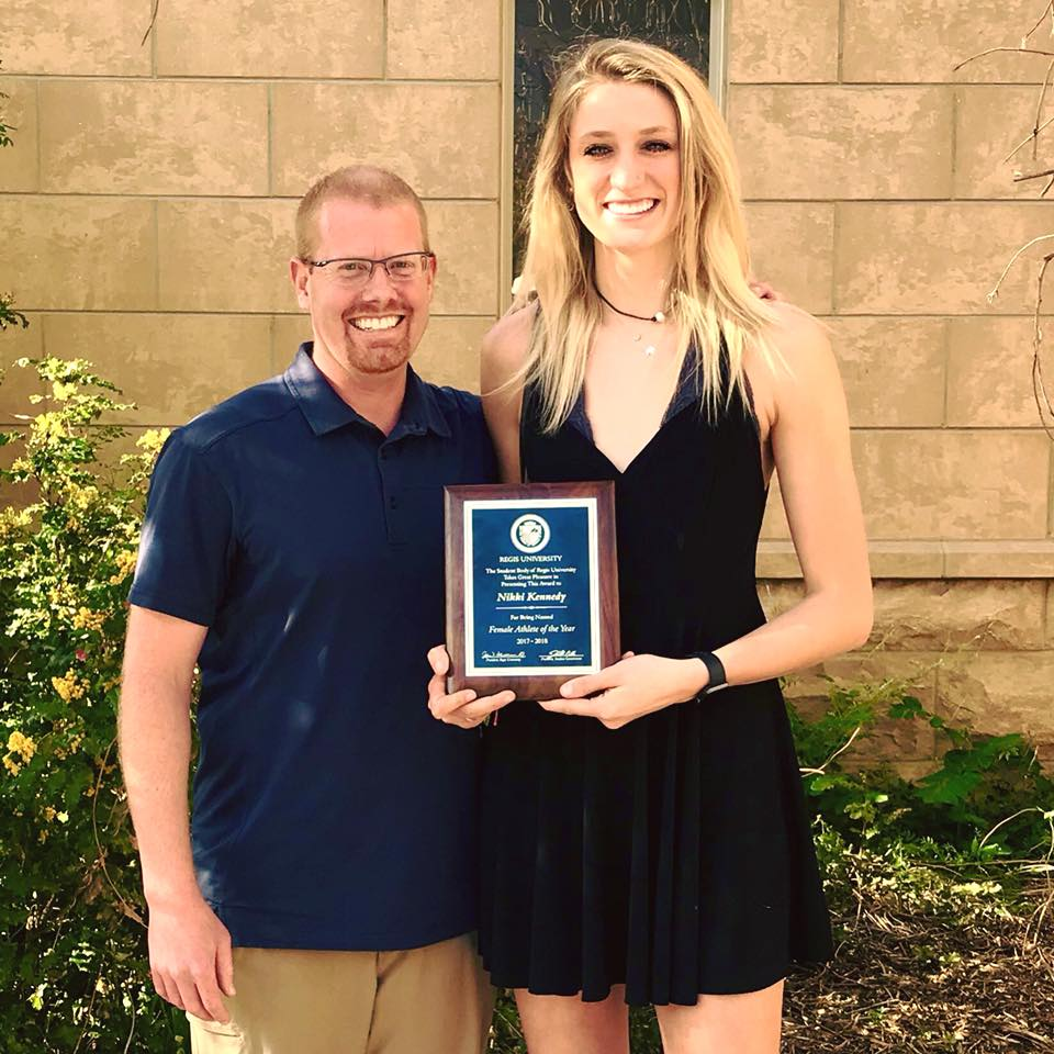 Nikki holds her Regis University award for Female Athlete of the Year, 2017 //Photo source: Regis University Volleyball Facebook Page