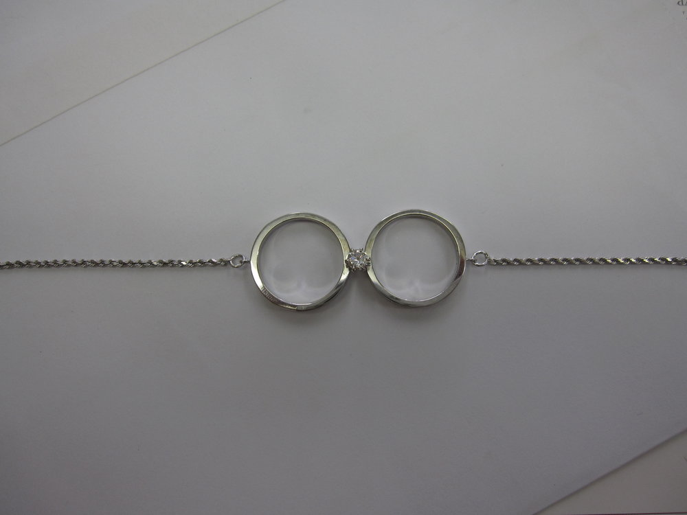 DAD died made rings into brac for their daughter's  top view 1.JPG
