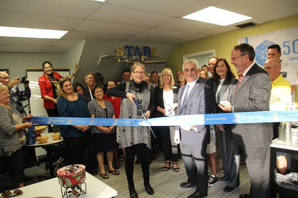 AUMi Ribbon Cutting Dec 2017.jpg