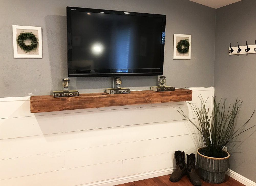 The mantle was a feature of the home that really tied the entire space together. It was custom built and tied in the wood accents in the home.