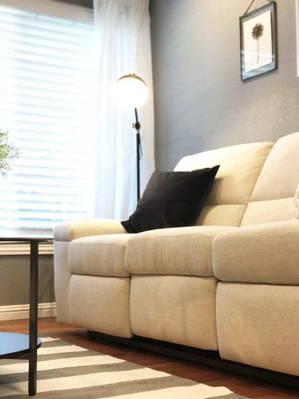 The recliner sofa was originally designed very different, but our team was able to redesign the shape of the sofa and brightened it up with a durable linen fabric.