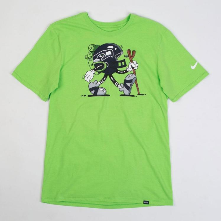 8. Nike x Steve Harrington Seattle Seahawks Tee - Brand: NikePrice: $30.00