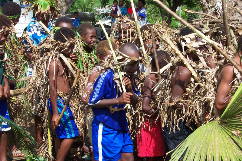 """At Pakarua Presbyterian the youth celebrate Palm Sunday in a traditional dance"", in Port Vila, Vanuatu, 2004"