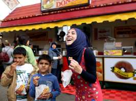 'I am so happy': Many firsts for Syrian refugees at Calgary Stampede