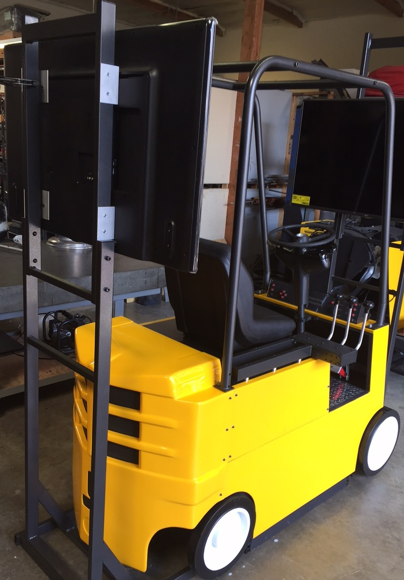 Full forklift simulator cab on workshop floor.