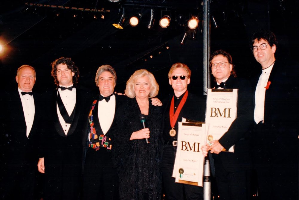 Terry accepts an award from BMI President, the late Frances Preston, and his publishers at the time