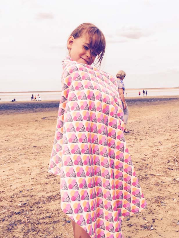 Ines    Coolest kid on the beach with her  Soft Gallery  beach towel.