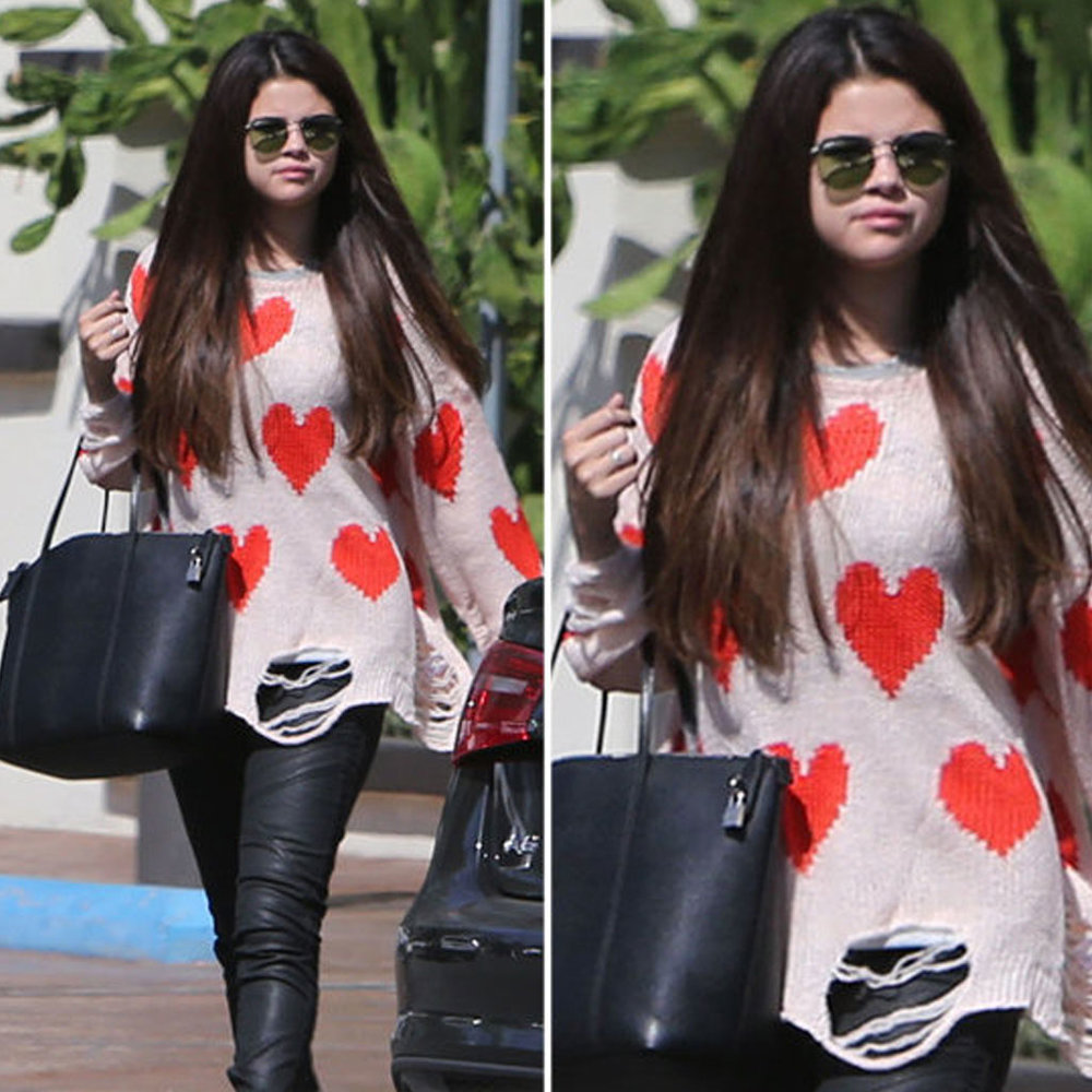 Selina Gomez We heart Selina Gomez in this WildFox heart print jumper