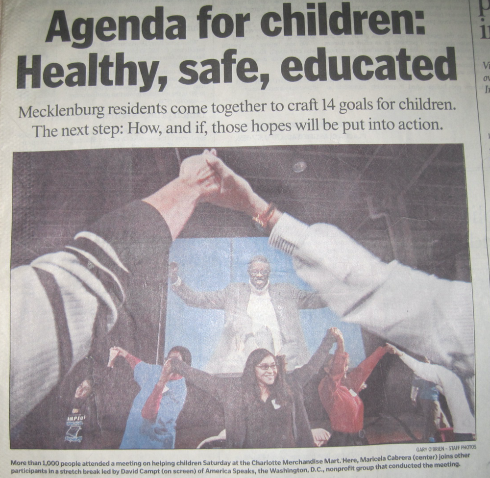 The cover of the Charlotte Sunday paper after a meeting of 1,000 people about children.